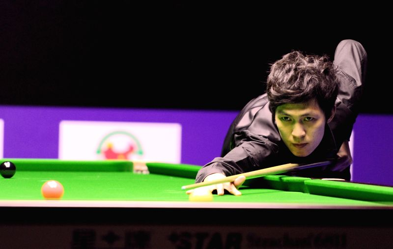 Thepchaiya Un-Nooh of Thailand competes during the semifinal against David Gilbert of England at 2015 World Snooker International Championship in Daqing, city of ...