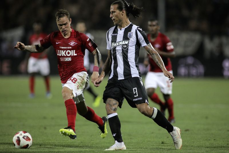 THESSALONIKI, Aug. 9, 2018 - PAOK's Aleksandar Prijovic (R) competes with Spartak Moscow's Andrey Eshchenko during the UEFA Champions League third qualifying round football match between PAOK and ...