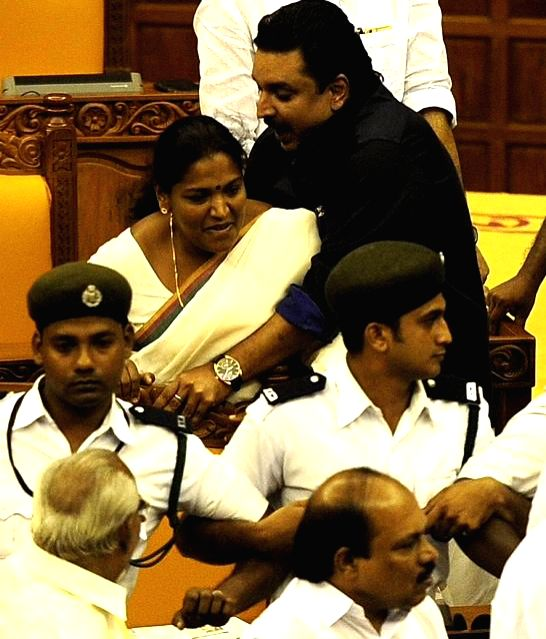 Kerala legislators go berserk in the state assembly during the budget session in Thiruvananthapuram on March 13, 2015.