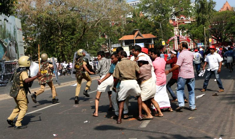 Policemen charge canes during an Left Democratic Front (LDF) demonstration in Thiruvananthapuram on March 13, 2015.