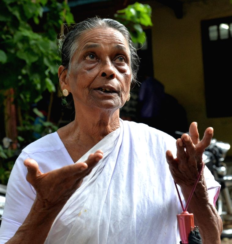 : Thiruvananthapuram: Prabhavathi Amma, mother of Udayakumar in front of the special CBI court in Thiruvananthapuram after hearing the verdict; in Thiruvananthapuram on July 25, 2018. A CBI Special ...