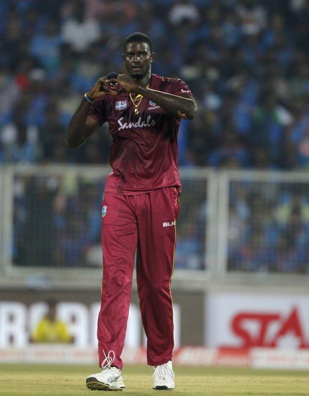 Thiruvananthapuram: West Indies' Jason Holder celebrates fall of Rohit Sharma's wicket during the second T20I match between India and West Indies at the Greenfield International Stadium in Thiruvananthapuram, Kerala on Dec 8, 2019. (Photo: Surjeet Ya