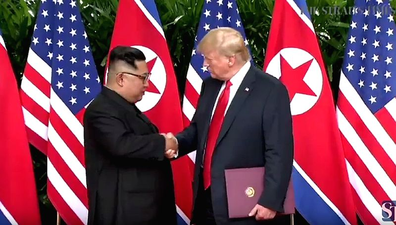 This photo, captured from The Straits Times, shows U.S. President Donald Trump and North Korean leader Kim Jong-un shaking hands after signing an agreement at the Capella Hotel in ...