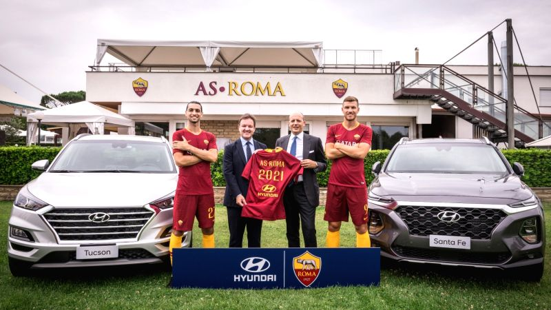 This photo provided by Hyundai Motor Co. on July 24, 2018, shows officials of Hyundai and the Italian professional football club posing for a partnership event.