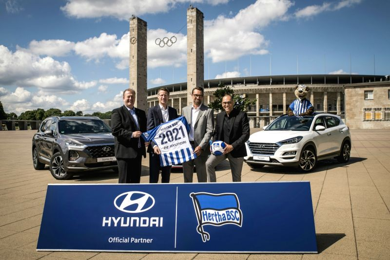 This photo provided by Hyundai Motor Co. on July 24, 2018, shows officials of Hyundai and the German professional football club posing for a partnership event.