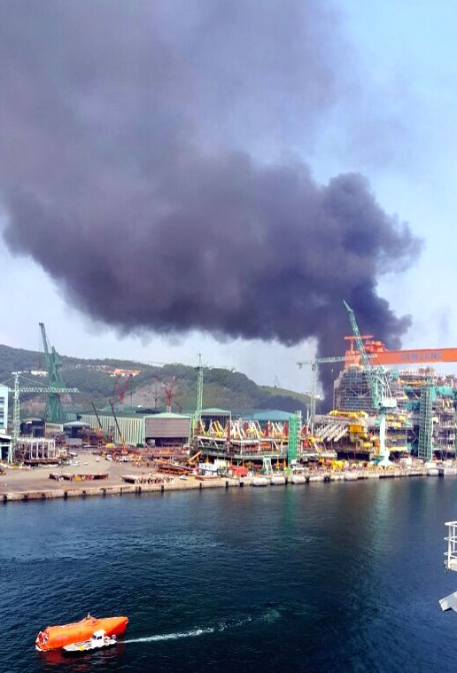 This provided photo shows black smoke billowing from the shipyard of Samsung Heavy Industries Co. in the southeastern port city of Geoje on May 17, 2017, after a fire broke out at the shipyard.