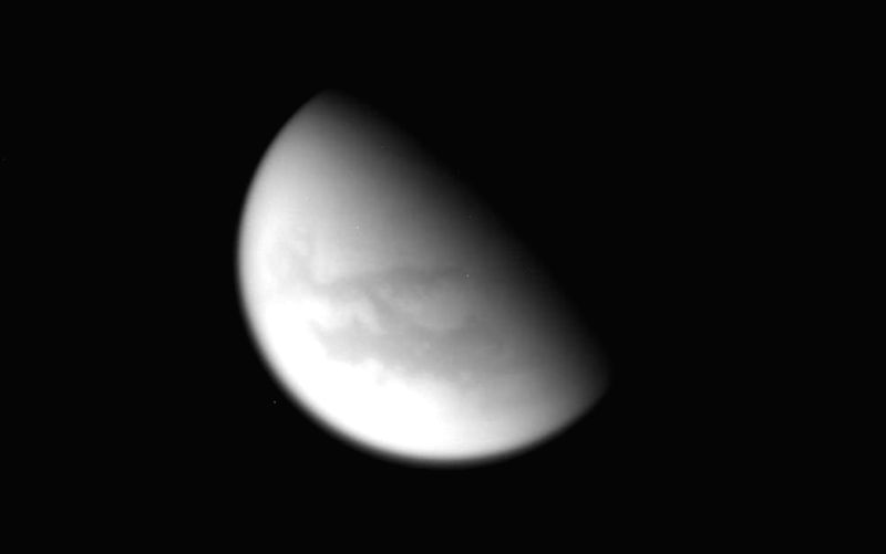 This unprocessed image of Saturn\'s moon Titan was captured by NASA\'s Cassini spacecraft during its final close flyby of the hazy, planet-sized moon on April 21, 2017. Photo: NASA
