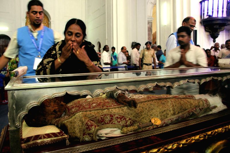 Thousands of devotees thronged to witness the decennial exposition of relics of St Francis Xavier at Basilica of Bom Jesus church in Old Goa (about 11km from Panaji) in Goa, on Nov 22, 2014. The ...