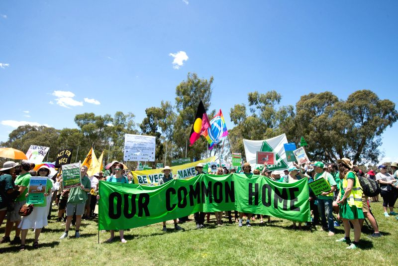 Thousands of people participate in the People's Climate March in front of the Old Parliament House in Canberra, Australia, Nov. 29, 2015. Thousands of Canberrans ...