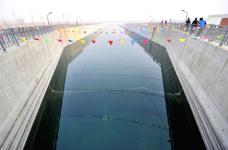 Photo taken on Dec. 27, 2014 shows water from the Yangtze River flowing into a waterworks as the middle route of the south-to-north water diversion project started .