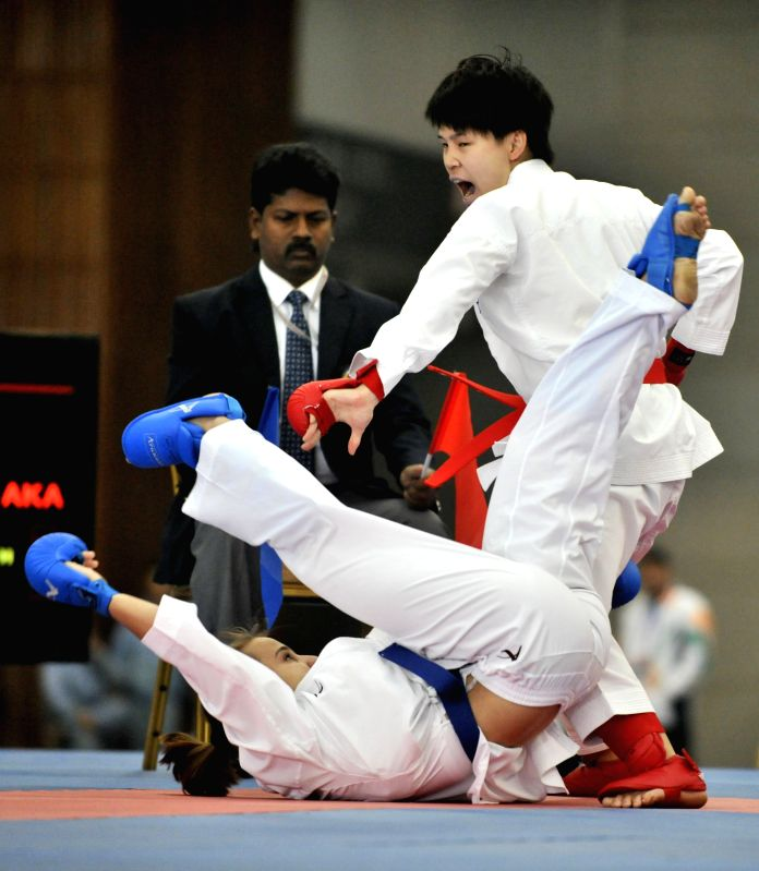 East Asia's Japanese player Shiho Tokai (R) competes with Mid-Asia's Kazahstan player Khupovets Yekaterina in the women's 50kg- contest of Karate during the women's group match at the 2nd ...