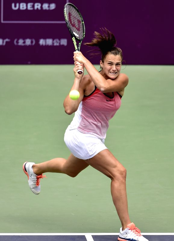 TIANJIN, May 27, 2016 - Aryna Sabalenka of Belarus returns the ball during the singles' quarterfinal against Peng Shuai of China in 2016 ITF Women's Circuit in north China's Tianjin Municipality, on ...