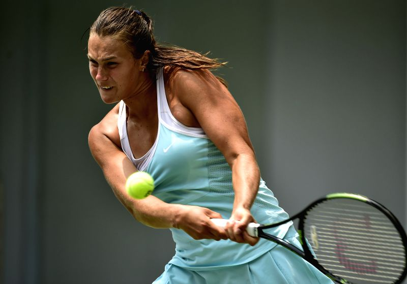 TIANJIN, May 29, 2016 - Aryna Sabalenka of Belarus returns the ball during the singles' final against Nina Stojanovic of Serbia in 2016 ITF Women's Circuit in north China's Tianjin Municipality, on ...