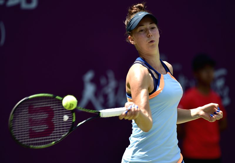 TIANJIN, May 29, 2016 - Nina Stojanovic of Serbia returns the ball during the singles' final against Aryna Sabalenka of Belarus in 2016 ITF Women's Circuit in north China's Tianjin Municipality, on ...