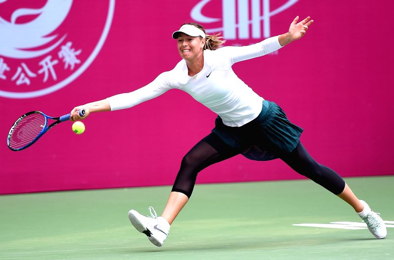 TIANJIN, Oct. 12, 2017 - Maria Sharapova of Russia hits a return during the women's singles second round match against Magda Linette of Poland at the 2017 WTA Tianjin Open in north China's Tianjin ...