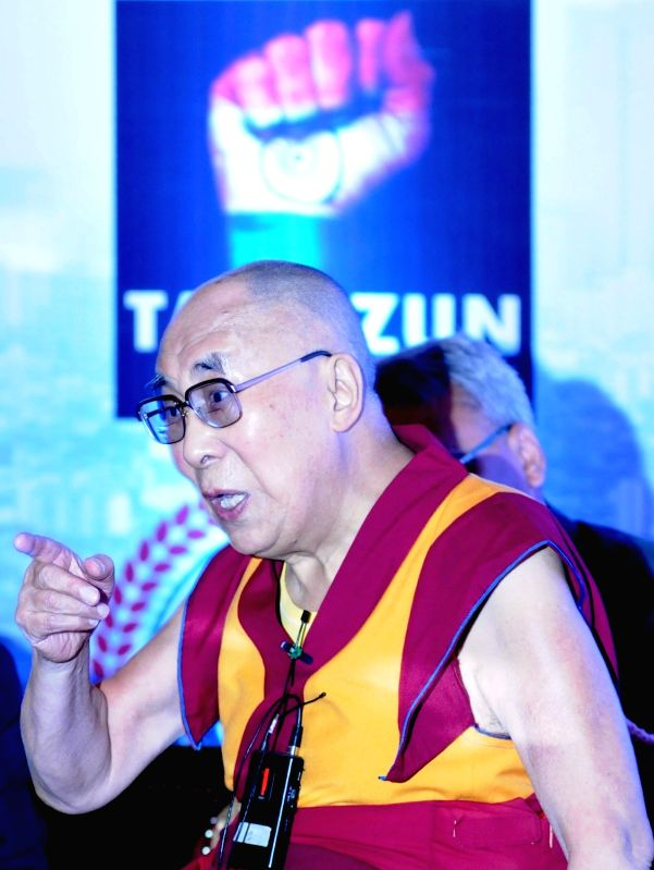Tibetan Spiritual leader Dalai Lama during a talk on Peace for Economy, in Bengaluru on Dec 6, 2015.