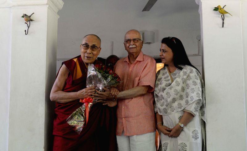 Tibetan spiritual leader Dalai Lama  meets BJP veteran LK Advani at his residence in New Delhi on April 25, 2017.