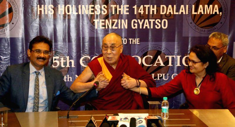 Tibetan spiritual leader the Dalai Lama addresses during a college programme in Jalandhar on Nov 14, 2015.
