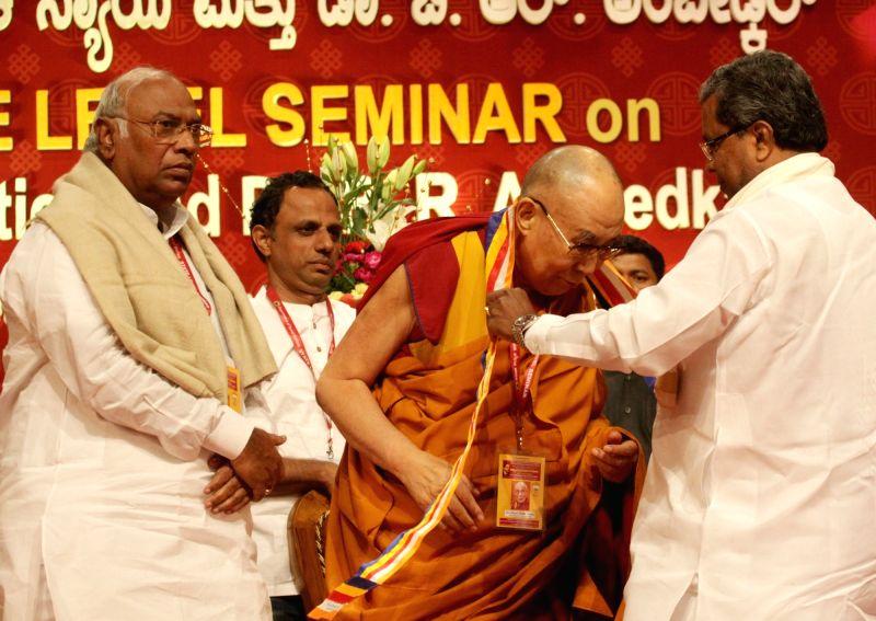 Tibetan spiritual leader, the Dalai Lama with Karnataka Chief Minister Siddaramiah and leader of the Congress parliamentary party in Lok Sabha Mallikarjun Kharge during a seminar on Social ... - Siddaramiah