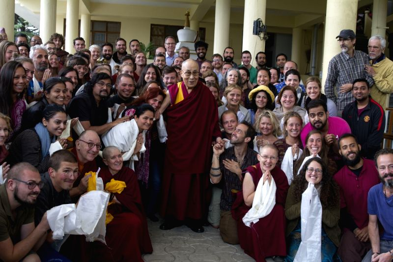 Tibetan spiritual leader the Dalai Lama with his disciples at Tsugla Khang Temple in Dharamshala on April 16, 2018.