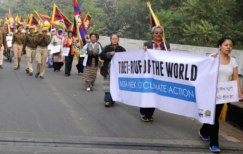 Tibetans participate in a rally to press for raising of Climate Action for Tibet in the Paris UN COP21 in New Delhi on Nov 29, 2015.