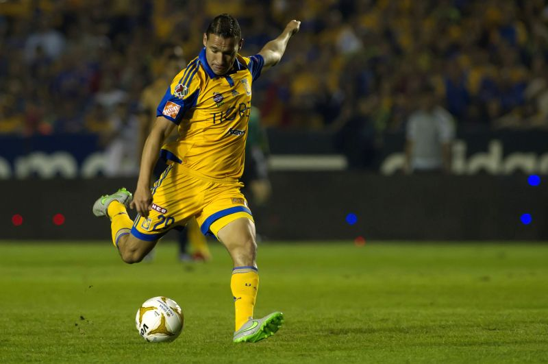 Tigres' Edgar Duenas shoots the ball during the first leg match against Pumas de la UNAM at the Final of the Opening Tournament of the MX League, held at the ...