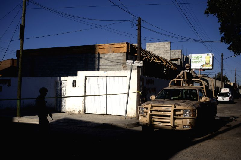 Soldiers guard the street of a house where a tunnel allegedly used for drug trafficking was found, in Tijuana city, northwest of Mexico, on April 28, 2015. ...