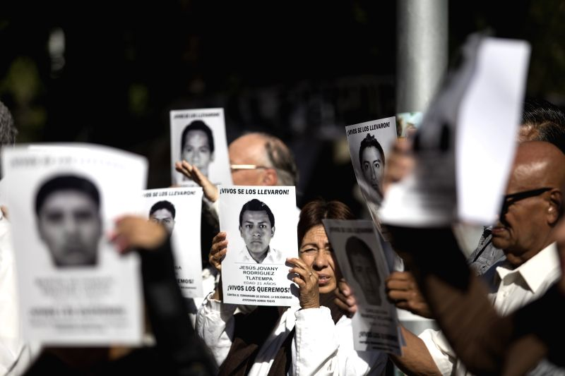 Residents take part during a peaceful demonstration held as part of the commemoration of the five months of the disappearance of 43 students from the Ayotzinapa ...