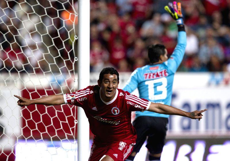 Alfredo Moreno (L) of Xolos celebrates his goal against Veracruz during a match of Journey 10 of MX League Clousure Tournament 2015 at Caliente Stadium in Tijuana ...