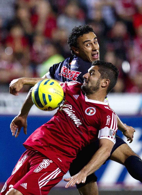 Javier Gandolfi (FRONT) of Xolos vies for the ball with Leobardo Lopez of Veracruz during a match of Journey 10 of MX League Clousure Tournament 2015 at Caliente ...