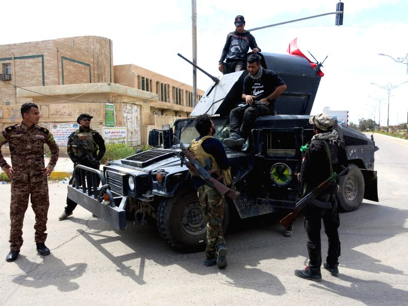A group of fighters from the Iraqi army are seen in Tikrit, Iraq, on April 1, 2015. Iraqi security forces Wednesday fought remaining pockets of Islamic State (IS) ...