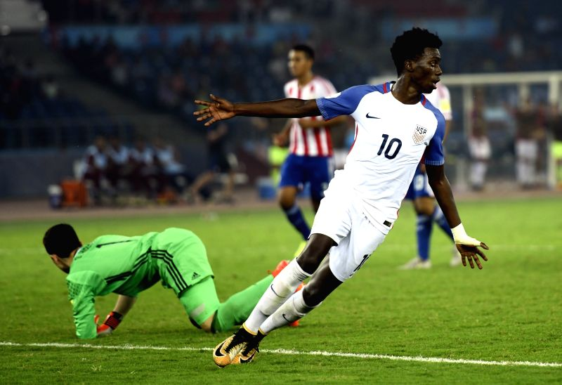Tim Weah (White Jersey No 10) of USA celebrates after scoring a goal during a Round of 16 match of FIFA U-17 World Cup 2017 between Paraguay and USA at Jawaharlal Nehru Stadium in New ...