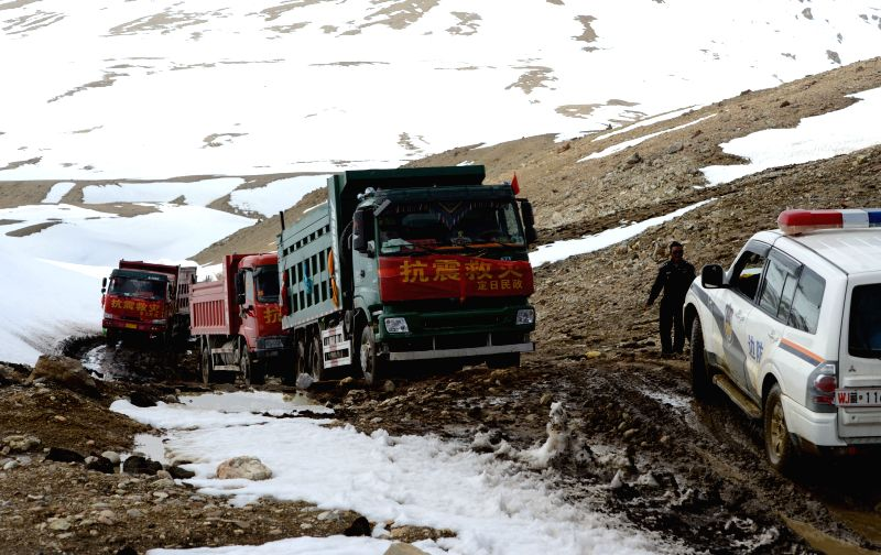 Rescue vehicles drive on a rugged road leading to quake-hit Rongxar Township, in Tingri County, southwest China's Tibet Autonomous Region, April 28, 2015. Rescue ...