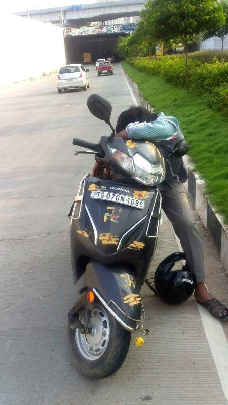 'Tipsy man on bike found asleep on Hyderabad road'