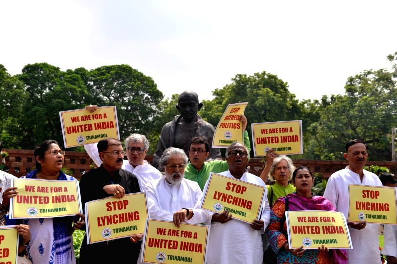 TMC MPs including Derek O'Brien, Sudip Bandyopadhyay and other party MPs stage a demonstration against the incidents of lynching in front of the Gandhi statue at Parliament, in New Delhi ...