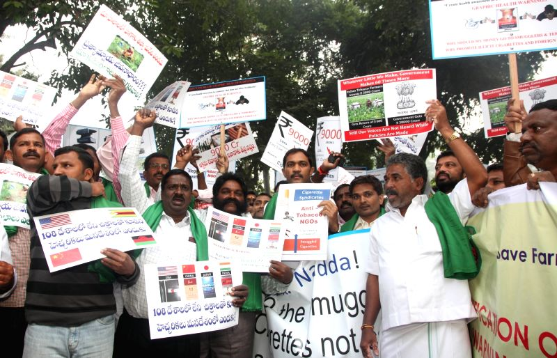 Tobacco farmers stage a demonstration outside Union Health Minister J P Nadda 's residence to press for their demands in New Delhi, on Dec 8, 2015. - J P Nadda