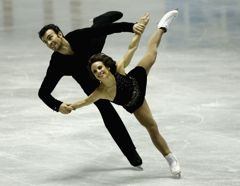 Meagan Duhamel (front) and Eric Radford of Canada perform during the Pair's short program at the International Skating Union's (ISU) World Team Trophy of Figure ...