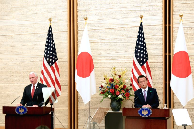 TOKYO, April 18, 2017 - U.S. Vice President Mike Pence (L) shakes hands with Japanese Prime Minister Shinzo Abe in Tokyo, Japan, on April 18, 2017. - Shinzo Abe