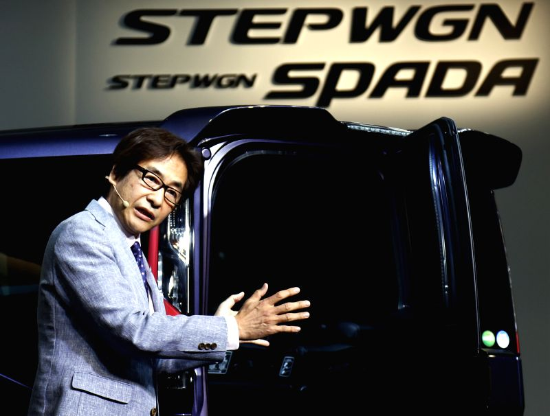 Honda Motors project leader Hitoshi Hakamada introduces the new model car of Stepwgn in Tokyo, Japan, April 23, 2015. Honda will put their new car into the Japanese ...