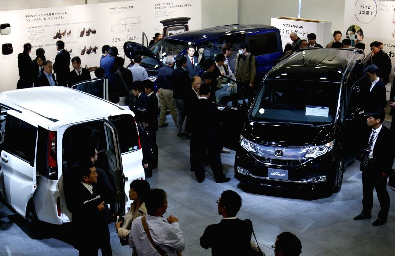 Journalists watch Honda's new model car of Stepwgn in Tokyo, Japan, April 23, 2015. Honda will put their new car into the Japanese market on April 24 with the price ...