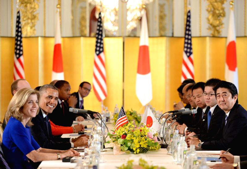 U.S.  President Barack Obama (L) stands with Japan's Emperor Akihito (C) and Empress Michiko  (R) during a welcoming ceremony at the Imperial Palace in Tokyo on ...