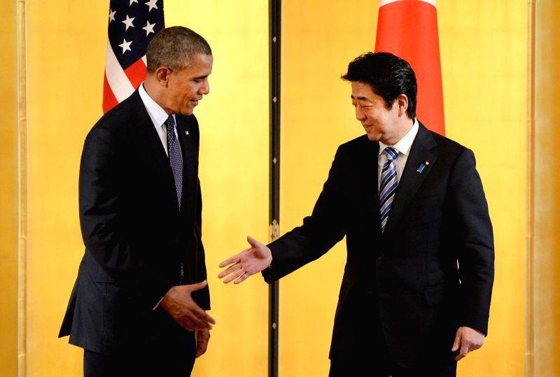 U.S. President Barack Obama (L) shakes hands with Japanese Prime Minister Shinzo Abe (R) at the Akasaka guesthouse in Tokyo on April 24, 2014. Visiting U.S. ... - Shinzo Abe