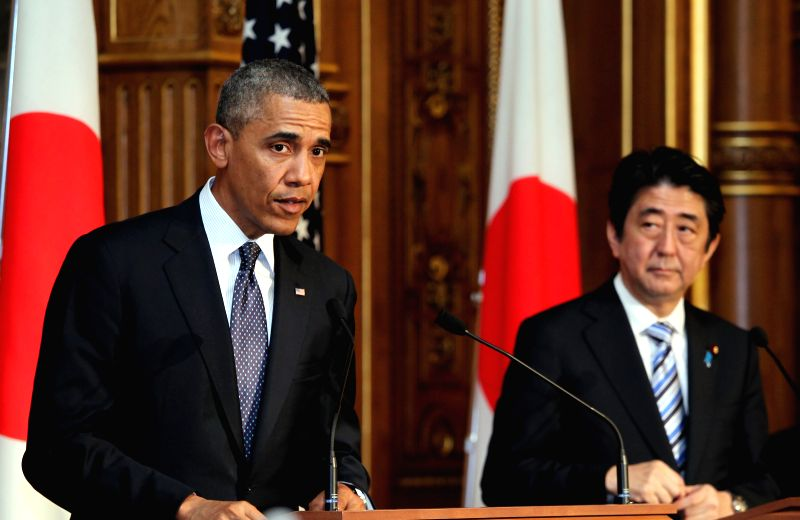 U.S. President Barack Obama (L) attends a press conference with Japanese Prime Minister Shinzo Abe (R) at the Akasaka guesthouse in Tokyo on April 24, 2014. Visiting - Shinzo Abe