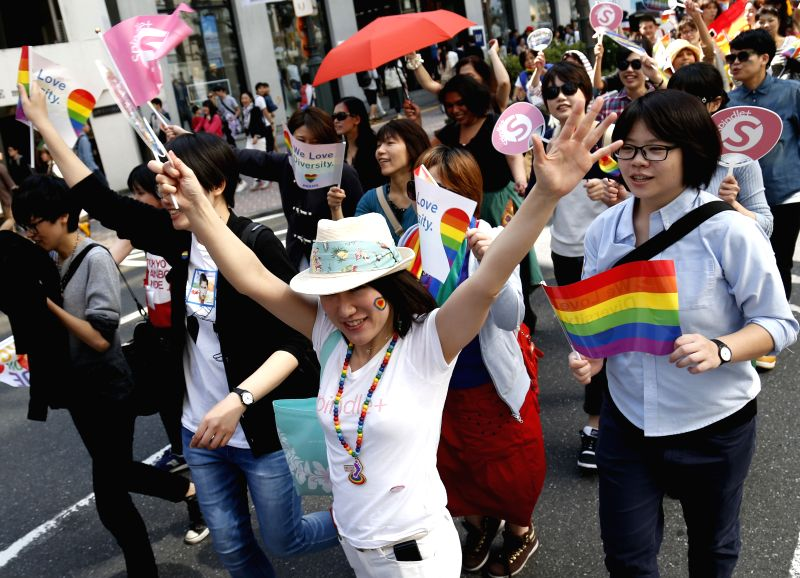 People take part in a parade at Tokyo Rainbow Pride 2015 in Tokyo, Japan, April 26, 2015. About 3,000 people participated in the parade of the Japan's biggest ...