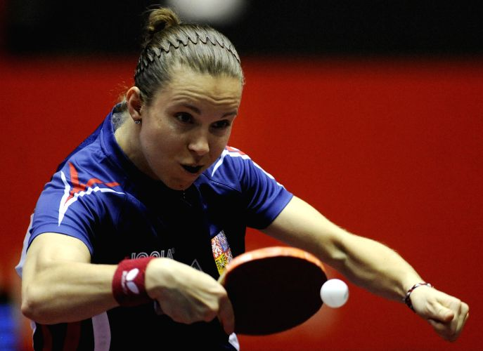 Hana Matelova of the Czech Republic competes with Jiang Huajun from Hong Kong of China during the women's single's match in Zen Noh 2014 World Table Tennis ...