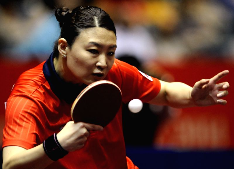 Iveta Vacenovska of the Czech Republic competes with Lee Ho Ching of Hong Kong of China during the women's single's match in Zen Noh 2014 World Table Tennis ...