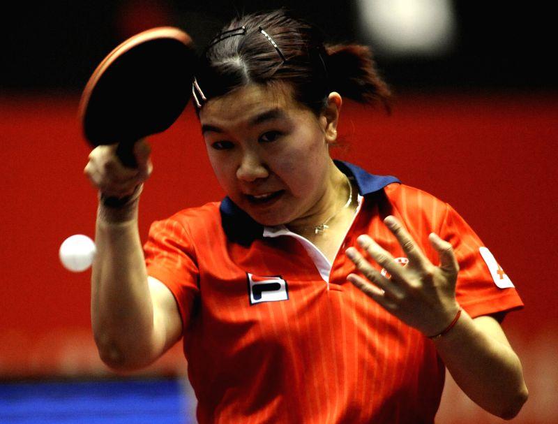 Jiang Huajun from Hong Kong of China competes with Hana Matelova of the Czech Republic during the women's single's match in Zen Noh 2014 World Table Tennis ...