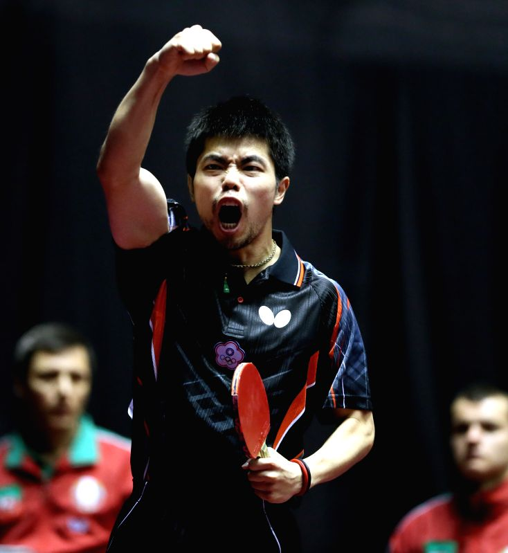 Chuang Chih-yaun of Chinese Taipei reacts after beating Vladimir Samsonov of Belarus at the men's singles round three match at the 2014 World Team Table Tennis ...