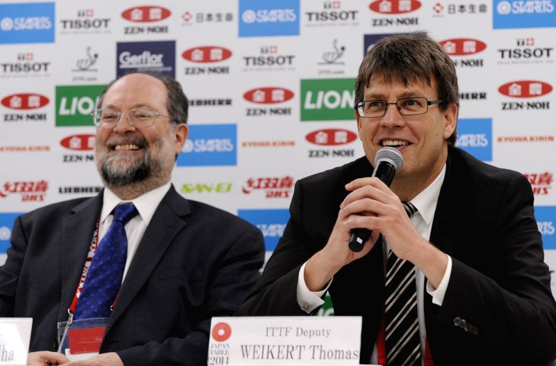 International Table Tennis Federation (ITTF) deputy president Thomas Weikert (R) and ITTF President Sharara Adam attend a press conferece in Tokyo, Japan, April 30, .