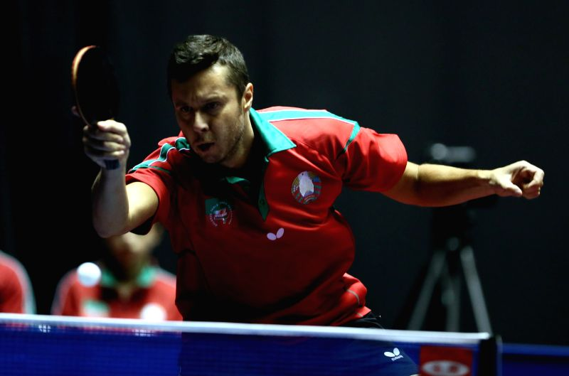 Vladimir Samsonov of Belarus hits a return during his men's singles round three match against Chuang Chih-yaun of Chinese Taipei at the 2014 World Team Table Tennis .